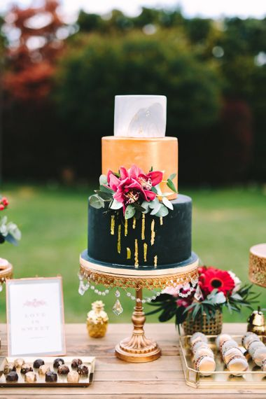 Three Tier Wedding Cake with Black, Gold and White Layers
