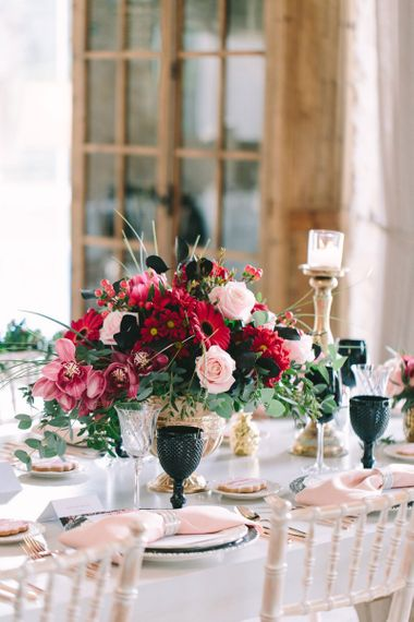 Red Flower Centrepiece in a Gold Vessel
