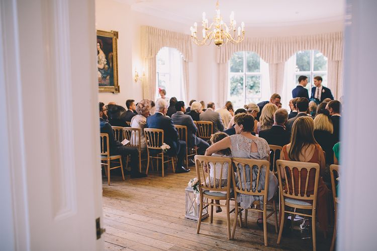 Civil Ceremony. A Quintessentially British Venue at Cambridge Cottage, Royal Botanic Gardens Kew. Bride Wears Paloma Blanca from Pure Couture Bridal and Groom Wears Tailored Suit from Hackett London.