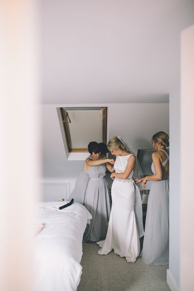 Bride's Morning Preparations. A Quintessentially British Venue at Cambridge Cottage, Royal Botanic Gardens Kew. Bride Wears Paloma Blanca from Pure Couture Bridal and Groom Wears Tailored Suit from Hackett London.