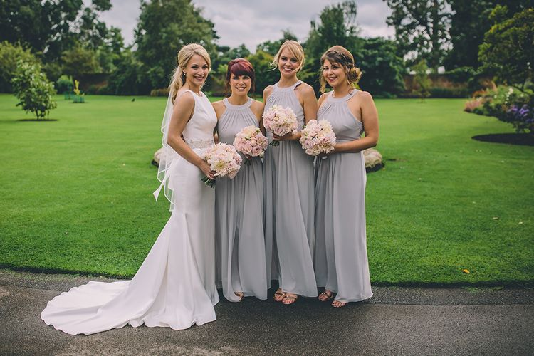 Bridesmaids Warehouse Dresses from ASOS. A Quintessentially British Venue at Cambridge Cottage, Royal Botanic Gardens Kew. Bride Wears Paloma Blanca from Pure Couture Bridal and Groom Wears Tailored Suit from Hackett London.