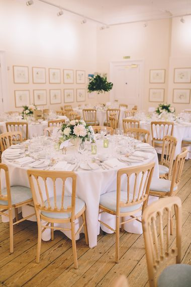 Table Settings.A Quintessentially British Venue at Cambridge Cottage, Royal Botanic Gardens Kew. Bride Wears Paloma Blanca from Pure Couture Bridal and Groom Wears Tailored Suit from Hackett London.