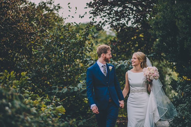 The Bride and Groom Share Some Time Together. A Quintessentially British Venue at Cambridge Cottage, Royal Botanic Gardens Kew. Bride Wears Paloma Blanca from Pure Couture Bridal and Groom Wears Tailored Suit from Hackett London.