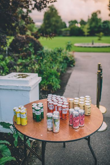 Gin in a Tin. A Quintessentially British Venue at Cambridge Cottage, Royal Botanic Gardens Kew. Bride Wears Paloma Blanca from Pure Couture Bridal and Groom Wears Tailored Suit from Hackett London.