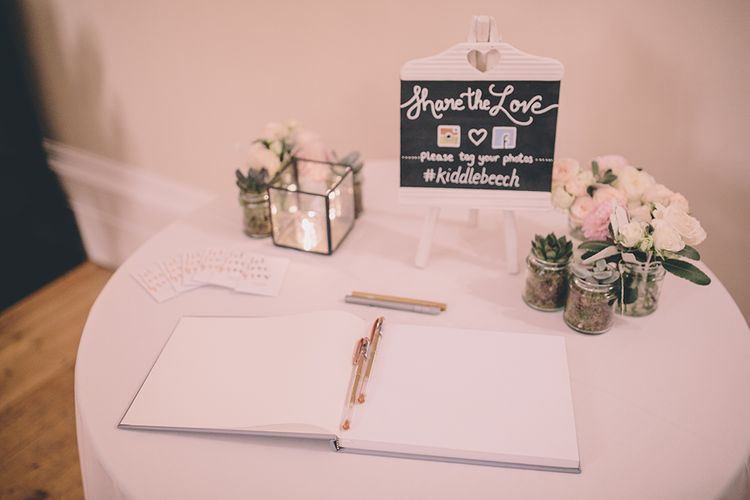 Guestbook. A Quintessentially British Venue at Cambridge Cottage, Royal Botanic Gardens Kew. Bride Wears Paloma Blanca from Pure Couture Bridal and Groom Wears Tailored Suit from Hackett London.