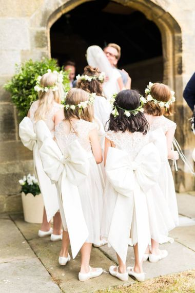 Traditional, all-white  dresses with giant bows