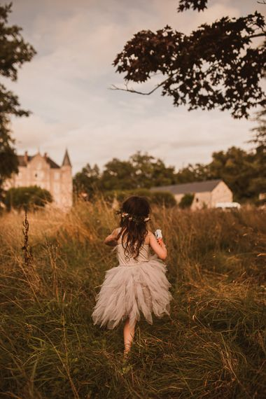 Girl in grey fairy dress with tulle skirt