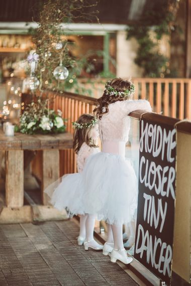 Flower girls in white tutus with blush pink jumpers