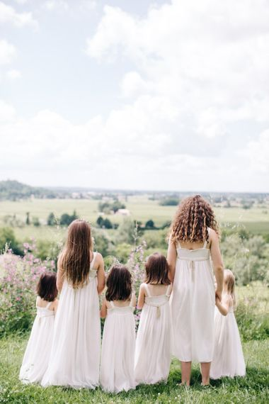 Entourage of little girls in white dresses
