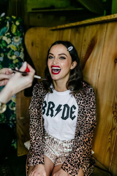 Wedding Morning Bridal Preparations with Bride in AC/DC T-shirt, Sequin Shorts and Leopard Print Robe