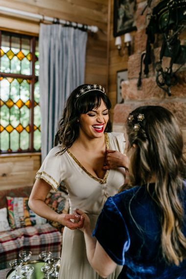 Bride in Vintage Wedding Dress, Gold Crown and Red Lipstick