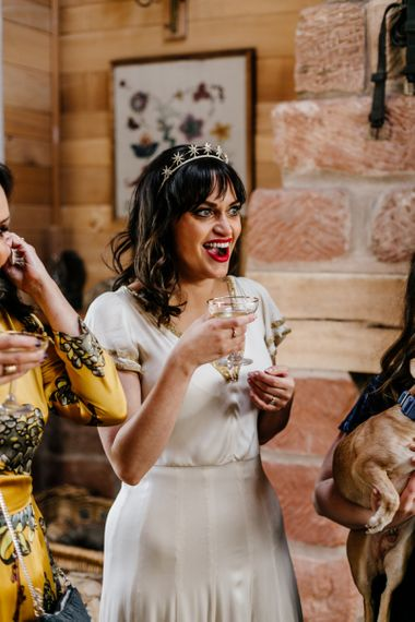 Bride in Vintage Wedding Dress Sipping Champagne