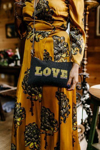 Stylish Wedding Guest Floral Dress and LOVE shoulder bag
