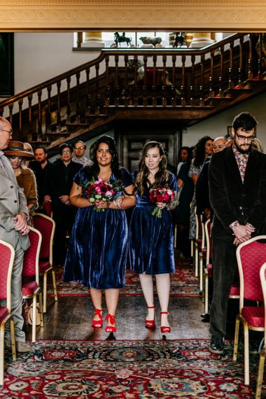 Bridesmaids in Navy Blue Velvet Lindy Bop Dresses and Red Shoes Walking Down the Aisle