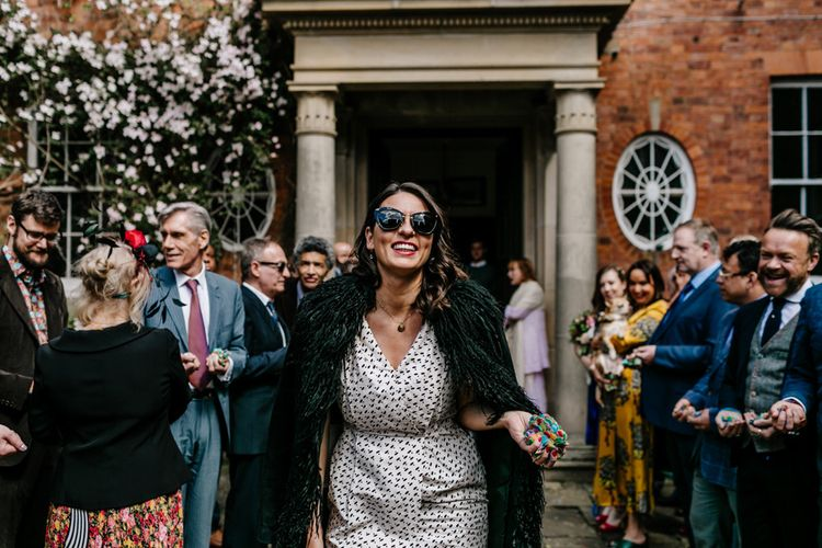Stylish Wedding Guests with Faux Fur Coat and Shades