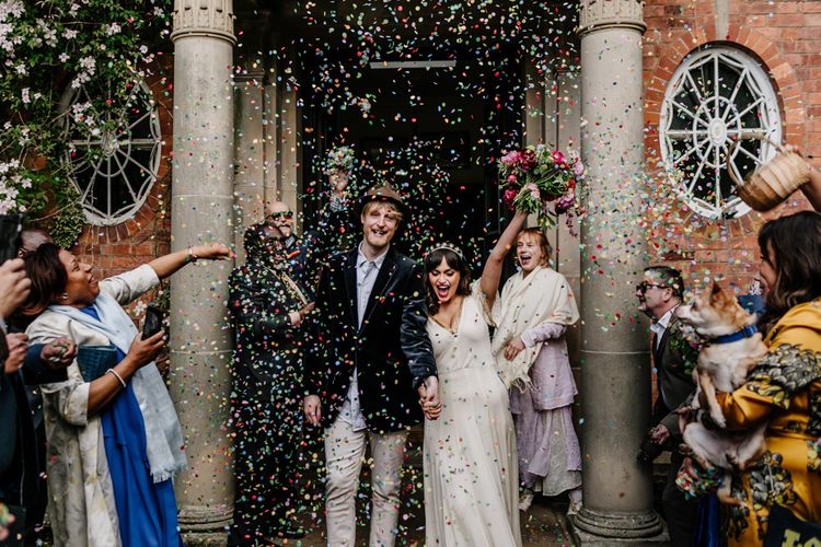 Confetti Exit with Bride in Vintage Wedding Dress and Groom in Velvet Blazer