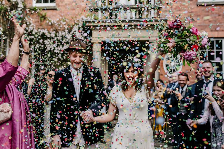 Colourful Confetti Moment with Bride in Vintage Wedding Dress and Crown and Groom in Velvet Blazer and Hat-065