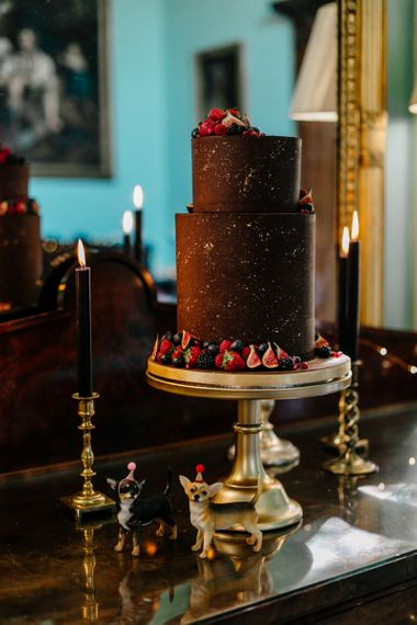 Two Tier Chocolate Covered Wedding Cake on Gold Cake Stand