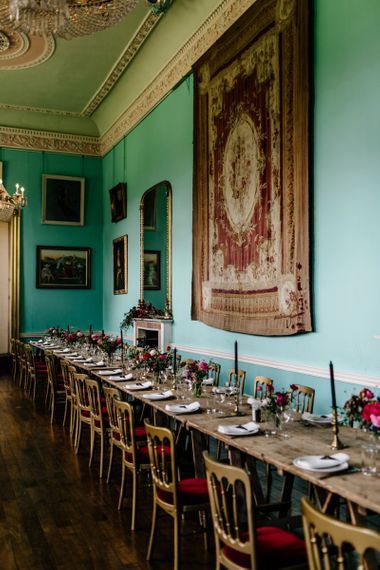 Walcot Hall Wedding Reception with Gold Chairs, Tapestry and Red Flowers