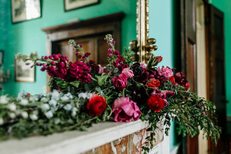 Deep Red and Pink Floral Arrangement with Foliage