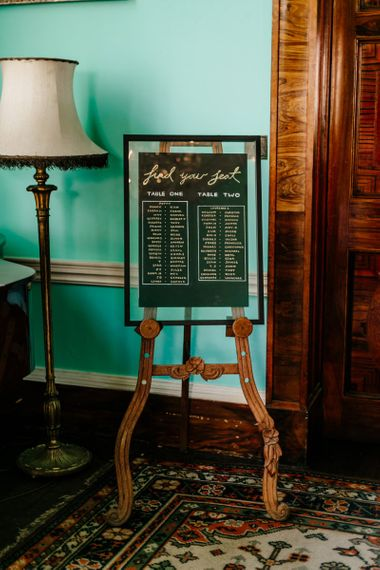 Black and Gold Wedding Seating Chart on an Easel