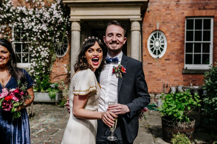 Bride in Vintage Wedding Dress and Crown with Her Bridesman in Bow Tie
