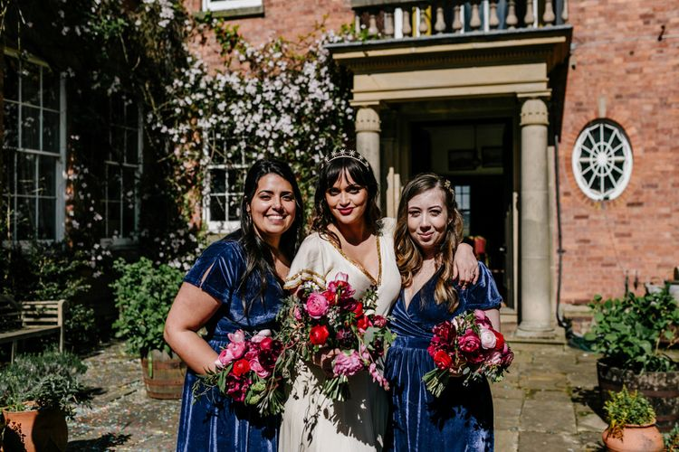 Bridal Party Portrait with Bridesmaids in Navy Blue Lindy Bop Dresses and Bride in Vintage Wedding Dress with Gold Trims