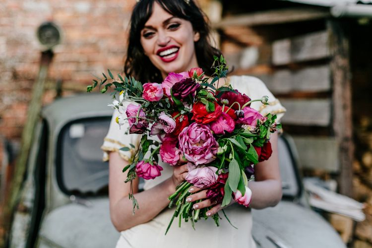 Deep Pink and Red Wedding Bouquet with Foliage