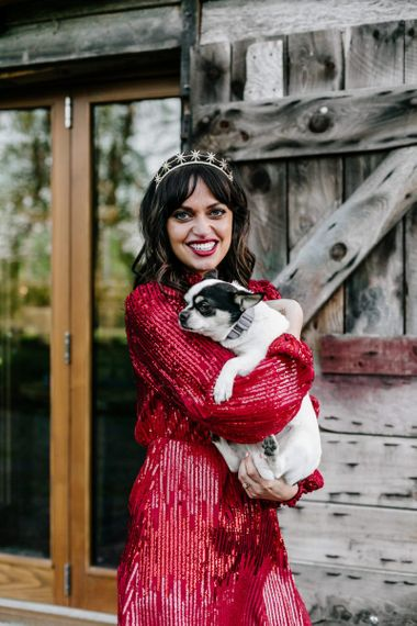 Stylish Bride in Sequin Red Evening Dress Holding Her Pet Dog124