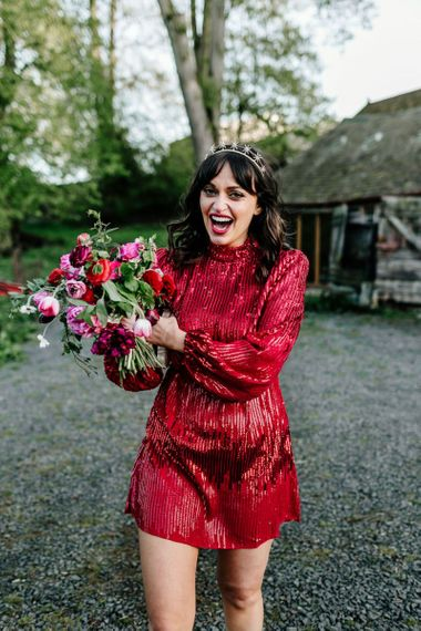 Stylish Bride in Sequin Red Evening Dress Holding a Red and Pink Wedding Bouquet25