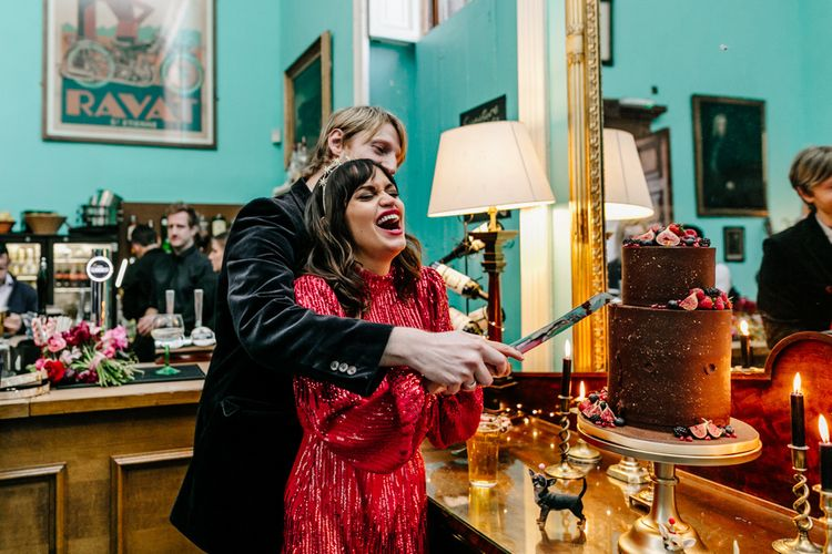 Bride and Groom Cutting the Chocolate Wedding Cake