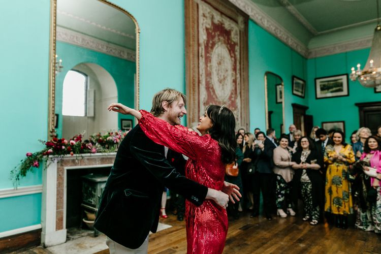 First Dance with Bride in Sequin Red Evening Dress and Groom in Navy Velvet Suit Jacket