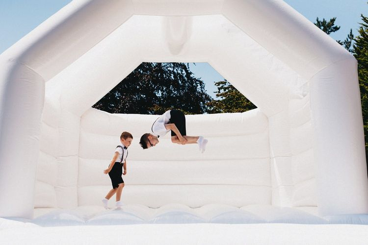 Bouncy Castle At Wedding // Image By Jason Williams Photography