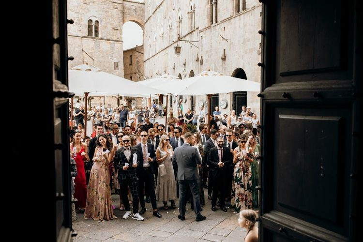 Guests watch bride and groom get married