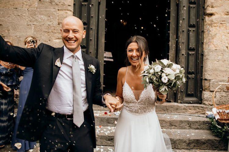 Bride and groom confetti exit at Italian wedding
