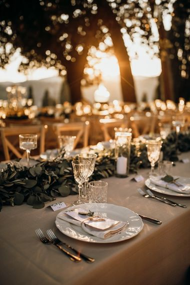 Wedding table decor with foliage table runner and candles