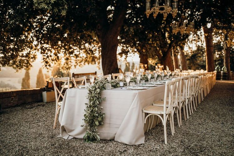 Stunning wedding table set up at Tuscan villa with foliage table runners