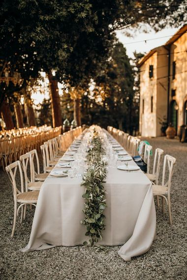 Stunning wedding table set up for Italian destination wedding with foliage table runners