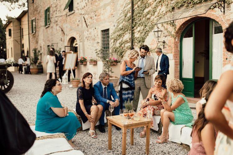 Wedding guests mingle at small Italian wedding