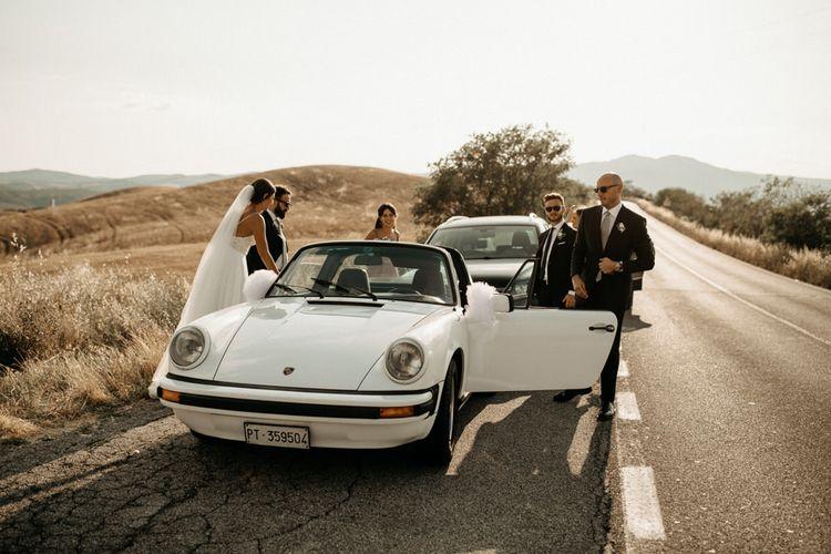 White wedding car at Italian intimate wedding