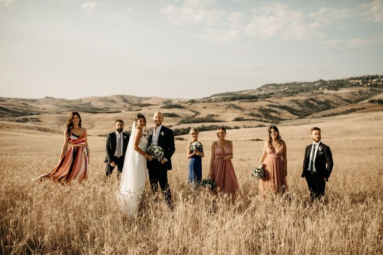 Bride with bridal party in pink bridesmaid dresses and groomsmen at Italian wedding