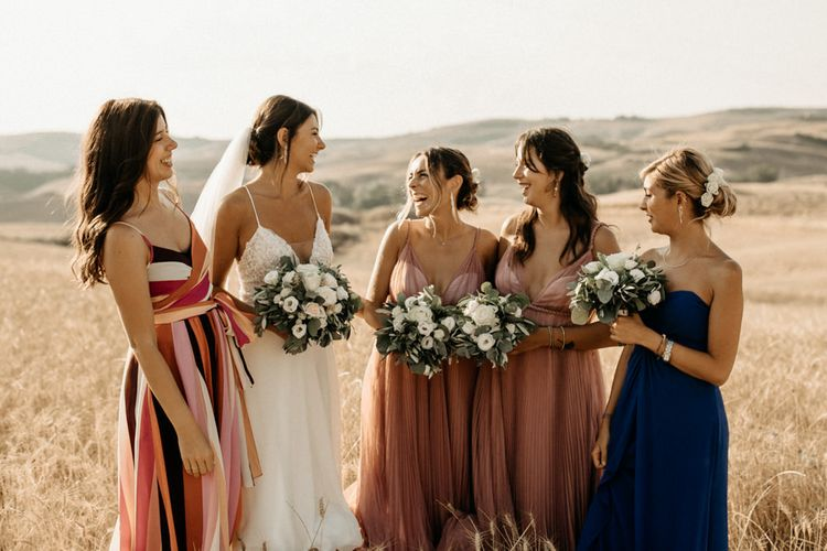 Bridal party with bride in Justin Alexander wedding dress