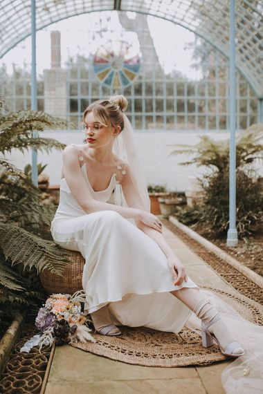 Bride in Glasses & Muscat Bridal Gown | Pastel Gerbera, Hydrangea & Pampas Grass Bouquet | Lavender, Peach & Black Geek Chic Wedding at Swiss Garden Fernery & Grotto, Shuttleworth | Planning & Styling by Rose & Dandy | Lola Rose Photography
