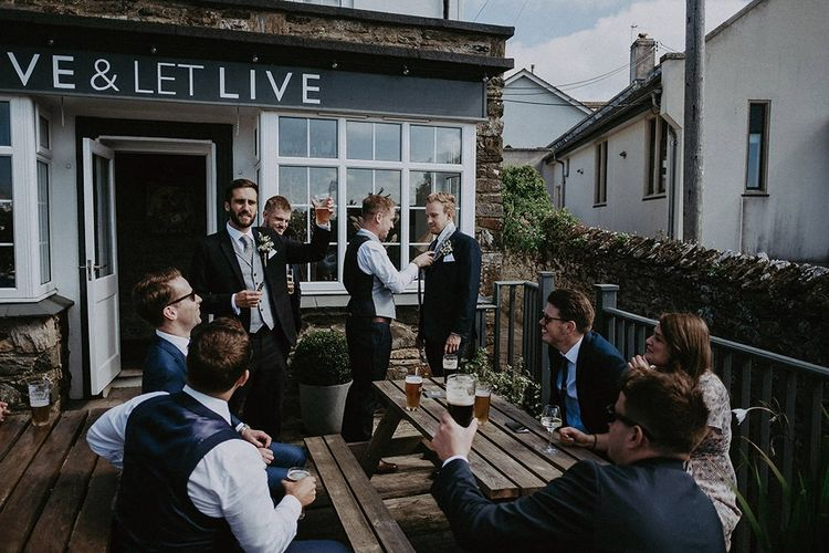 Groom and groomsmen visit pub before wedding