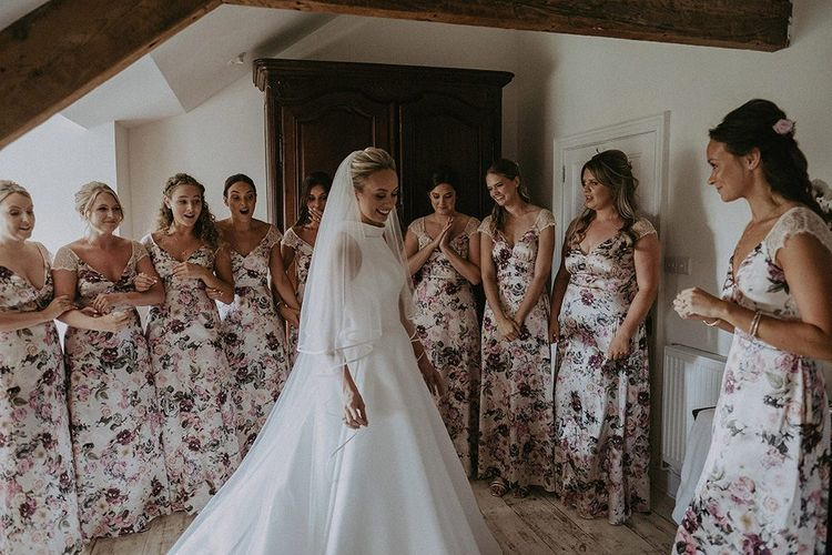 Bridesmaids see bride in Suzanne Neville wedding dress