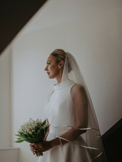 Suzanne Neville wedding dress with veil and undo