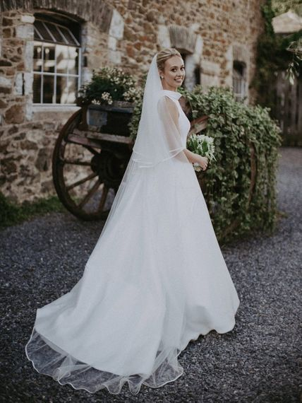 Suzanne Neville wedding dress with veil