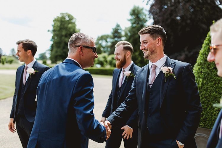 Groom & Groomsmen In Navy Blue Suits // Geometric Details & Hanging Foliage For Hengrave Hall Wedding With Outdoor Reception With Images From Sam And Louise Photography