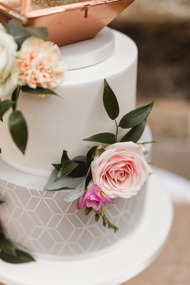 Iced Wedding Cake With Geometric Details // Geometric Details & Hanging Foliage For Hengrave Hall Wedding With Outdoor Reception With Images From Sam And Louise Photography