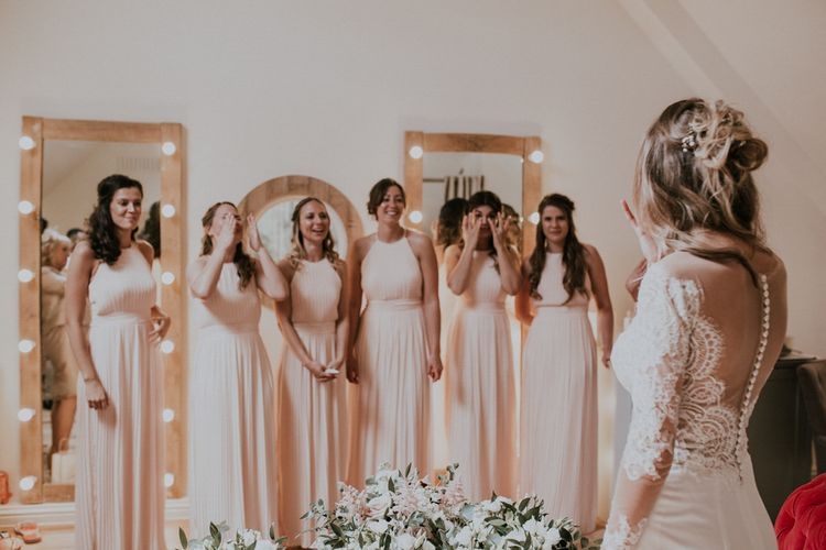 Bridesmaids First Look | Pink Halterneck Pleated Dresses | Bride in Madison James Bridal Gown | Millbridge Court, Surrey Wedding with DIY Decor, Foliage & Giant Balloons | Nataly J Photography